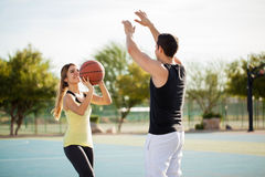 pretty-couple-shooting-some-hoops-fun-hispanic-playing-basketball-against-each-other-having-lots-fun-62105861