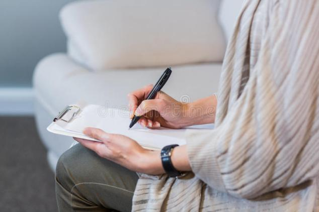 psychologist-sitting-couch-taking-notes-office-53856121 (1)