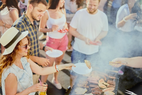 Group of friends having a good time at outdoor party
